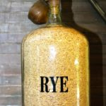 Rye grain stored in a labeled container.