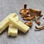 Bothwell Cheese, whose seasonal extra-old cheddar with Untamed Feast's alder-smoked wild Chanterelle mushrooms is shown here, plans to launch new varieties of Non-GMO Verified cheddar in 2017. (BothwellCheese.com)