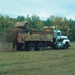 Whitecourt-area farmer Chad Merrifield uses spreader trucks to land apply pulp sludge to his cropland post-harvest.