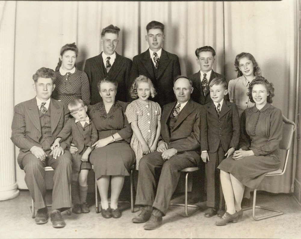 C.C. (left) and Anna Toews, with their children and 'Uncle Corny.' In front (left to right) Gerry, Eleanor, Allen, and Erma. In the rear, Gladys, Henry, Fred, Wes, and Ruth.