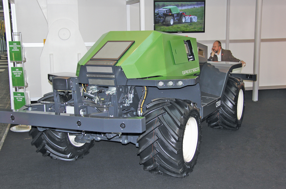 The tractor has both front and rear three-point hitches and PTO.