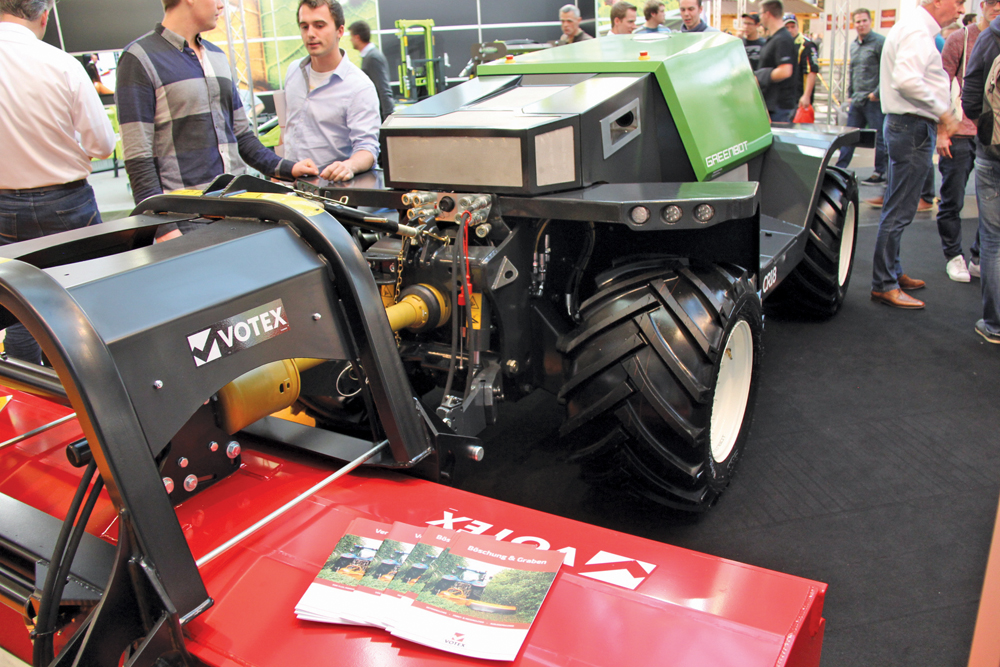 An Autonomous Greenbot tractor with attached roto-tiller on display at Agritechnica.