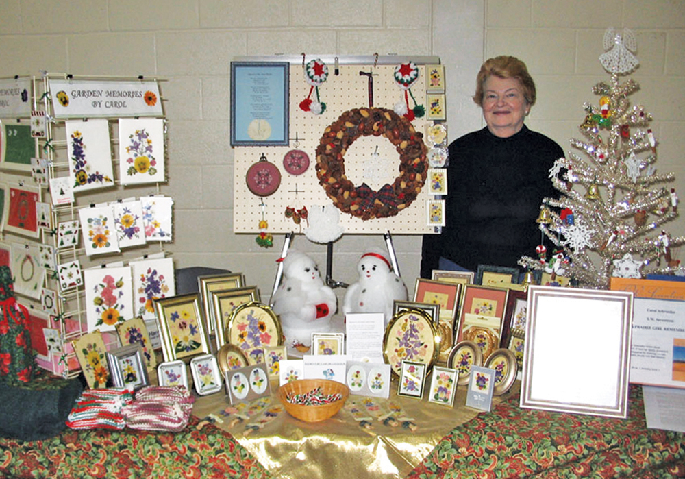 Carol Schroeder with her artworks.