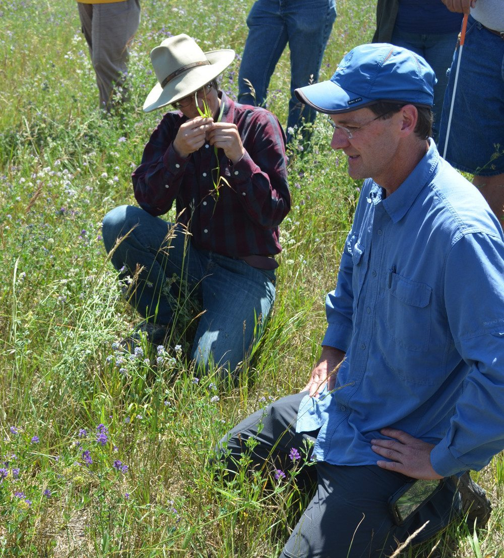 Michael Thiele (r), grazing club co-ordinator with the Manitoba Forage and Grasslands Association spoke on the importance of organic matter in pasture soil at a recent grazing workshop.