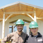 Lundar School carpentry teacher Donald Nikkel (l) oversees the school's Industrial Arts home-building project giving students like 16-year-old Cauy Kinkead valuable training and skills.