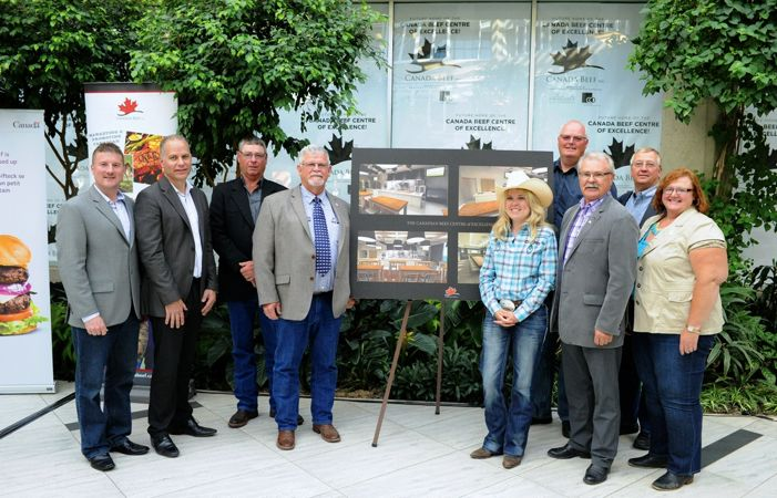 The announcement of the new Canadian Beef Centre of Excellence drew a crowd of officials. From left to right: Canada Beef president Rob Meijer, directors Mike Kennedy and Jack Hextall, chair Chuck MacLean, Western Economic Diversification Minister Michelle Rempel, Agriculture Minister Gerry Ritz, and director Jennifer MacDonald. Director Willie van Solkema and Red Deer MP Earl Dreeshen are at the rear.