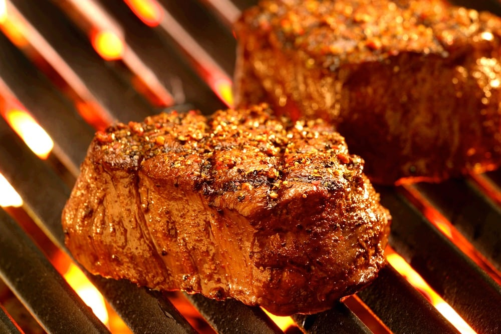 steaks on hot grill