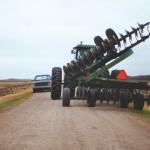 farm equipment on a gravel road