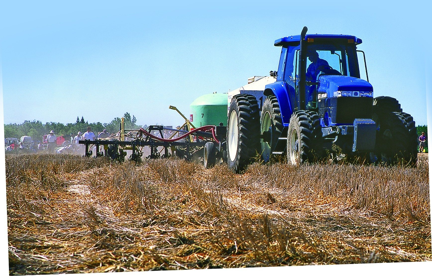 Tractor applying fertilizer to a field.