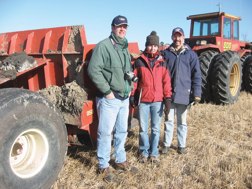 David Lobb (l) of the University of Manitoba, with master's student Michelle Erb and Treherne-area farmer Dallas Timmerman in November 2004 while working on a study into tillage-eroded soils and the efficacy of moving the eroded soil from low parts of the field back to the hilltops.