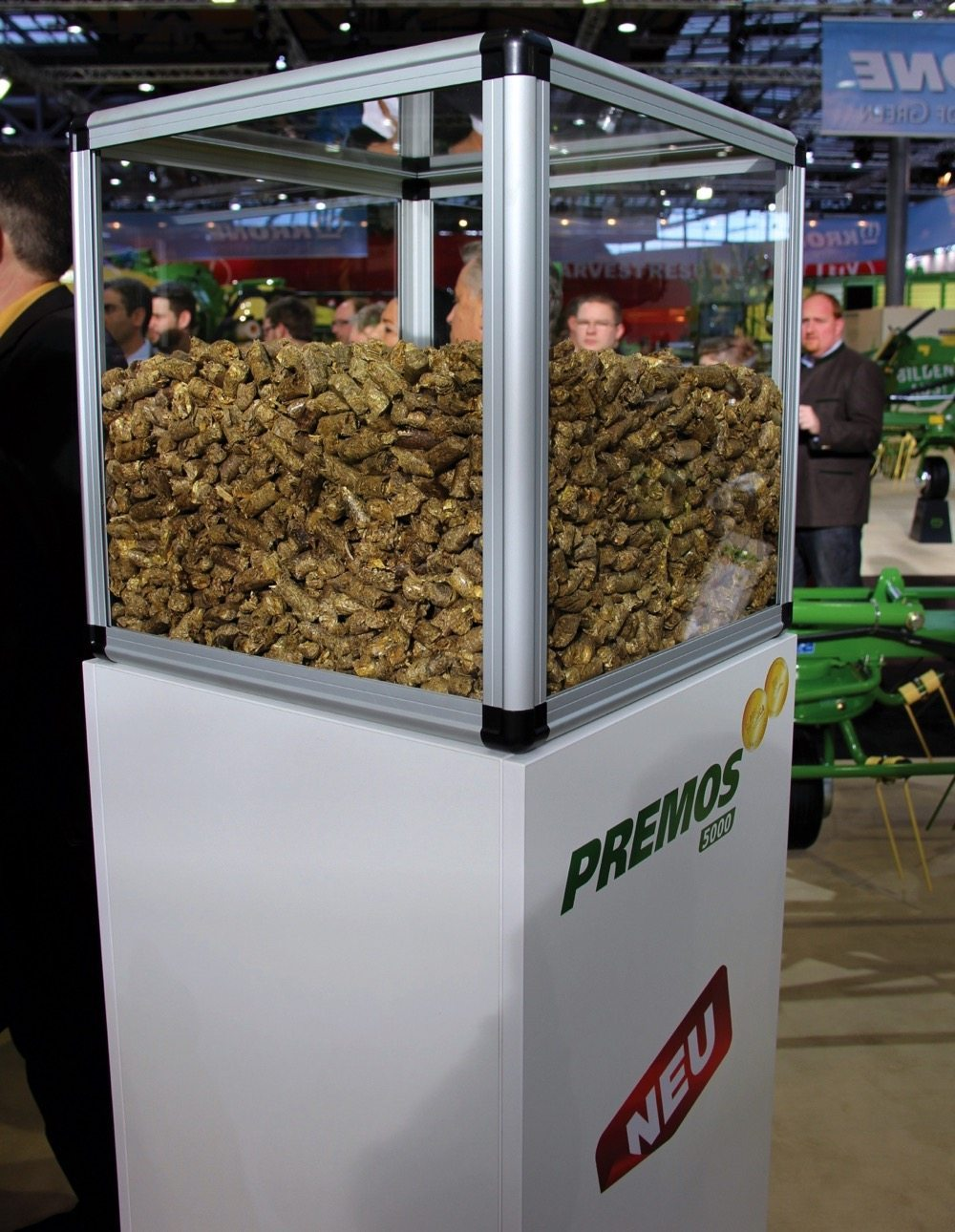Krone displayed a glass case full of pellets made by the Premos 5000 at their Agritechnica exhibit.